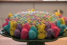 1 box of yellow cake mix 1 can of white colored frosting 1 bag of plain pastel colored M & Ms Assorted marshmallow Peeps and bunnies  Preparation:  Prepare cake according to the box's directions.  Let it cool completely. Frost the entire cake. Arrange the M & Ms on top of the cake in a mosaic-like pattern.  Attach the Peeps and bunnies around the cake.  Adhere with extra frosting if necessary.