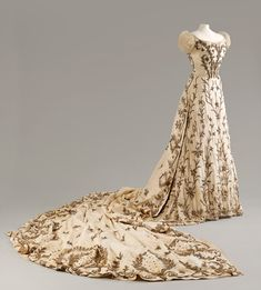 """The House of Worth designed this opulent embroidered gown ca. 1900-1903 for Lady Curzon, the Vicereine of India. Courtesy Fashion Museum, Bath and Northeast Somerset Council. Discovered this on display at Yale. Bath told me they had """"a couple of"""" Mary's dresses, but I never saw THIS!!! Maybe *after* the Peacock Dress..."""