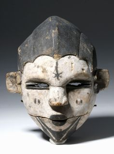 Nigeria, Ogoni peoples, ca. early 20th century CE. This is a very nice example of a cane wood Ogoni dance mask, featuring a face with thin slits for eyes, tiny puckered lips, and pronounced ears and nose. The hair is tightly braided and the face is painted to show scarification and tattoos on cheeks, near ears, and forehead. The Ogoni encountered European colonists quite late - 1901 was the year they encountered the British - so their artistic tradition retains many pre-colonial elements…