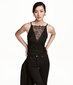 Black. Sleeveless jersey top with narrow shoulder straps and a lace-covered V-neck at front. $12.99