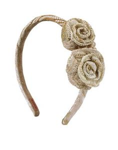 Lurex ripple knit hairband decorated with rosebuds in same fabric.