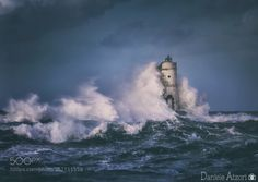 The Lighthouse Mangiabarche 2 by danielino79 sea clouds italy lighthouse canon seascape storm faro sardegna alba sulcis calasetta mangiabarche Th