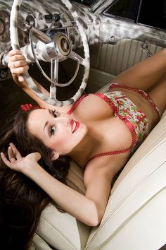 Pin-Up Girls love in the car for the mechanic guy