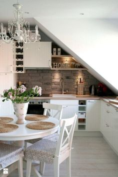 Lovely white small kitchen and dining space with a rustic flair