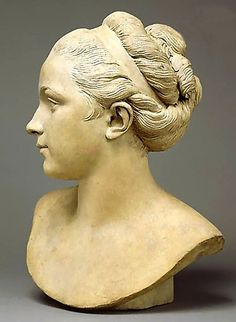 Bust of woman with twisted hair arrangement.