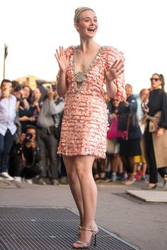 Elle Fanning was in her comfort zone in a frilly, light-pink dress by Miu Miu