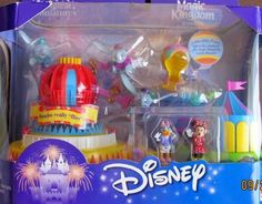"""Disney Magic Kingdom DUMBO THE FLYING ELEPHANT Playset Magical Miniatures DUMBO REALLY """"FLIES""""! (2000) by Mattel. $145.98. Box approx. 9"""" x 7-1/2"""" x 5"""". For Box Condition see CONDITION NOTE or Email Seller for Details.. HARD TO FIND Disney Magic Kingdom Dumbo The Flying Elephant Playset Magical Miniatures is a 2000 Mattel production.. CONTENTS: Playset, Circus Area with Trampoline, Collectible Cloud Float, Removable Balloon, Minnie Mouse Figure approx. 1-1/4"""" tall, & Daisy Duck ..."""