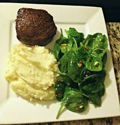 Filet Mignon, mashed potatoes, and bacon and spinach salad.