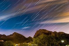 Last weekend we had a stay-cation on the northwest side of town  with a great view of Pusch Ridge from our balcony. I shot a timelapse at night for a couple hours There was a lot of cloud cover for most of the timelapse but there was a window of about 140 frames with less clouds and some stars just before the moon rose. This is a stack of those 140 frames. And the light change from the moon rise left for a really nice teal and orange effect in the sky. ______________ #startrails #space…
