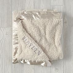 Shop Cuddle Me Softly Baby Blanket (Stone).  The knit construction of our Cuddle Me Softly Baby Blanket makes it so soft you'll wish it was available in adult sizes, too.  Available in three colors, it features a satin edge for a refined look.