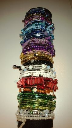 Collection of glass bead bangles made by Roxichik Designs