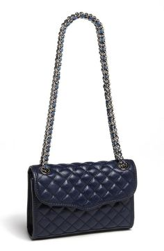 Timeless style: A quilted handbag with a chain and leather strap.