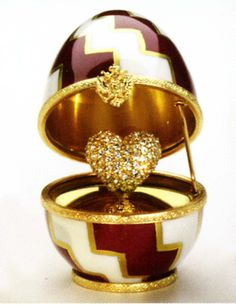 "Faberge Egg: Imperial Heart Surprise Egg	 Imperial Heart Surprise Egg. These precious petite Faberge eggs (2.5"" height) are handcrafted in Limoges, France. In the centuries old Faberge egg tradition, they each carry a 24K gold-plated surprise to celebrate special moments or occasions. Each egg is signed, numbered, and exquisitely packaged in a blue Faberge gift box with satin lining."