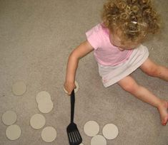 Blueberry Pancakes- You make blue dots on circles of paper- two sets of each number- The child then uses a spatula to flip over the matching pancakes--Great pre-school/kindergarten activities on this site.