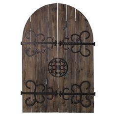Door-inspired wood plank wall decor with metal scrollwork detail.    Product: Wall dcorConstruction Material: Wood and metalColor: Brown and blackDimensions: 48.5 H x 16 W