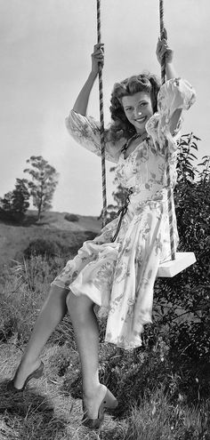 Rita Hayworth swinging by in charming warm weather style.