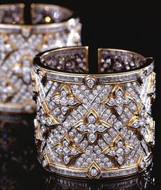 PAIR OF DIAMOND CUFF BANGLES, REPOSSI. Each hinged cuff designed as a wide band of pavé-set brilliant-cut diamonds highlighted by quatrefoil motifs similarly-set, the borders composed of rows of step-cut diamonds, mounted in white and yellow gold, Diamond Bracelets, Diamond Jewelry, Bangle Bracelets, Bling Bling, Best Diamond, Diamond Cuts, Women's Accessories, Ring Armband, Diamond Are A Girls Best Friend