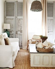 Living room, tall salvaged shuttered doors, slipcovers, country/rustic look