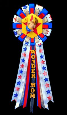 Wonder Mom Baby Shower Corsage Mommy to Be Wonderwoman Pin -Mom to Be Badge Sleeping Baby Clay Favor -Royal Blue Red Gold Patriot Ribbon Mum - pinned by pin4etsy.com