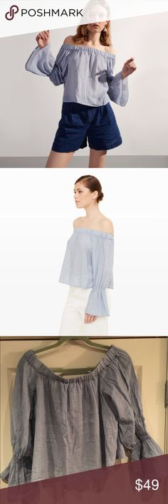 Club Monaco Off the Shoulder Top Only Worn Once! Perfect Condition! True to Size. Pretty Light Blue Color. Airy Light Fabric. Elastic at top off the shoulder detail & elastic at sleeves for bell shape. Not fitted, flowy. Club Monaco Tops