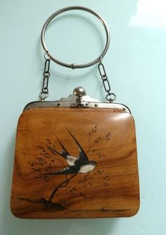 Wooden purse with barn swallow design.