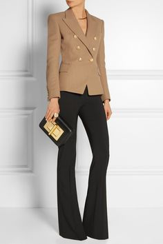 balmain jacket and black flared pants