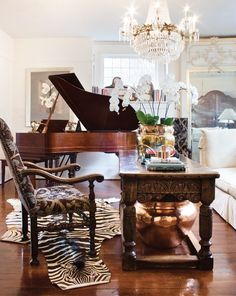 Very luxe small space living room decorated with antique furniture ~ Ryan Townsend