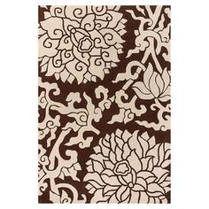 Exotic blossoms lend hints of chinoiserie to this handcrafted rug, highlighted by New Zealand wool pile in an inviting chocolate palette. Product: RugConstruction Material: New Zealand woolColor: Chocolate and cream Features: Design by Thomas PaulHandcraftedCotton backing Note: Please be aware that actual colors may vary from those shown on your screen. Accent rugs may also not show the entire pattern that the corresponding area rugs have.Cleaning and Care: Professional cleaning recommended