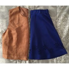 """cutout skater skirt Brand is """"Entro"""" purchased from Patty's Closet boutique. Photos are true to color, a very deep blue. Excellent used condition. Very minor pilling at the bottom. Daisy cutouts are only at the front. Measures 11.5"""" waist, can stretch up to 2-3"""". Waist to hem is 16"""". Care tag is faded. Topshop Skirts Circle & Skater"""