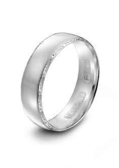 Tacori mens platinum wedding bandTacori platinum men's slightly rounded wedding band featuring signature Tacori hand-engraving and milligrain detail.