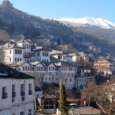 In the center of Gjirokastra, the Kotoni B&B with snow-covered Mali Gjere in background.