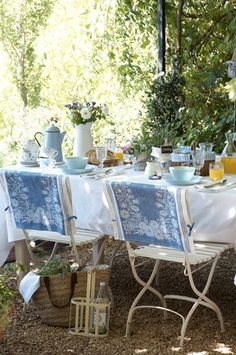lovely setting - I love the tied tea towel covers on the chairs