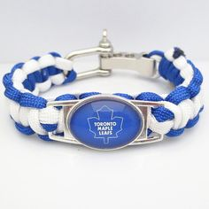 Toronto Maple Leafs Hockey Paracord Bracelet Be one of the first to get one of these sporty Paracord Toronto Maple Leafs Hockey Team Survival Bracelets. Made with genuine 550 strength parachute cord.