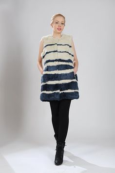White and blue stripes vest of rabbit fur. Available for wholesale orders.