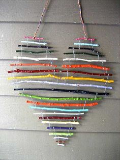 Painted stick heart - Outdoor Decorating Ideas with Hearts for This Valentines Day