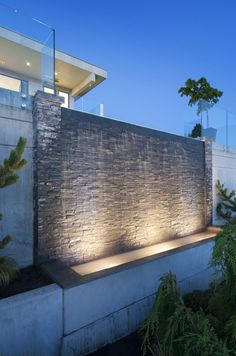 ALKA POOL - This impressive water wall acts as a water feature bringing an added elegance to the home with the added benefit of noise cancelling the nearby traffic. www.alkapool.com