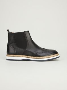 Black leather 'Chelsea' boot from Soulland featuring a round toe, elasticated side panels, perforated detailing, a pull tab at the rear and a contrast sole.