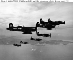 "Some of the carrier's F4U ""Corsair"" fighters and AD ""Skyraider"" attack planes rendezvous off the North Korean coast.  Photo is dated 15 August 1951.  The F4U in the foreground is from squadron VF-791. ADs are from squadron VA-702."