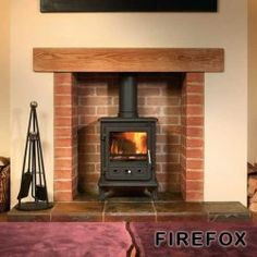 Family Room wood burning stove decor - built to look like a fireplace Fireplace Pictures, Fireplace Logs, Cast Iron Fireplace, Fireplace Design, Fireplace Ideas, Brick Fireplaces, Cottage Fireplace, Fireplace Remodel, Fireplace Surrounds