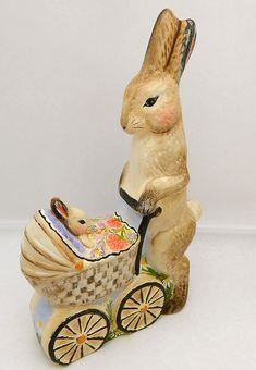 Chalkware Mother rabbit and baby carriage from antique chocolate mold.