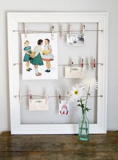 Great use of an old frame, wire and clothespins to display art, reminders, biz cards, photos, etc.