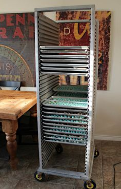 If you bake lots of cookies and don't own one of these babies, you need to.  This shiny silver contraption is called a bun pan rack.