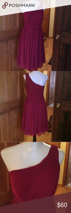 "GORGEOUS BARI JAY formal dress This GORGEOUS Bari Jay dress is in excellent condition. Perfect for prom, weddings, cruise, or any special occasion!  Color is a deep maroon/garnet.  Outer is flowy and shear inner is fully lined.  Dress is listed as an 8 however feels a little smaller (more like a 6). Measurements are:  Length from waist to hem is approx 26"".  Waist approx 26-28"".  Chest is approx 32-34"". Bari Jay Dresses One Shoulder"