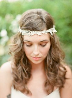 Adorned with flowers and crystal embellishment, this stunning halo can be worn with or without a veil! | Wedding Hair Ideas | Bridal Hairstyle | Wedding Hair Accessories | Bridal Halo | Wedding Headpiece