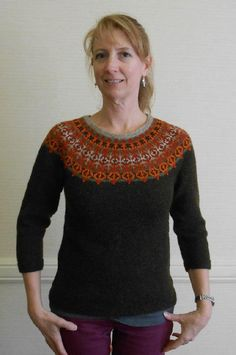 The Helsinki Sweater is a graceful yoke design with short rows and waist shaping to give a flattering fit. The body of the sweater is a deep olive green; the many oranges and subtle greens of the Turkish motif in the yoke give an overall effect of mid-century Scandinavian pottery designs: thus, the name Helsinki Sweater. Eight shades of Jamieson's Shetland Spindrift fingering-weight yarn are used in this sweater. The body and sleeves are easy, you might say mindless!, knitting; the yoke h...