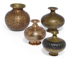 Christie's A GROUP OF FOUR BRASS LOTA  MUGHAL 17TH/19TH CENTURY  The bodies of rounded bulbous form, rising to the strongly waisted neck and slightly flaring rims with various moulded and incised decoration 6 5/8in. (16.8cm.) high max. (4)