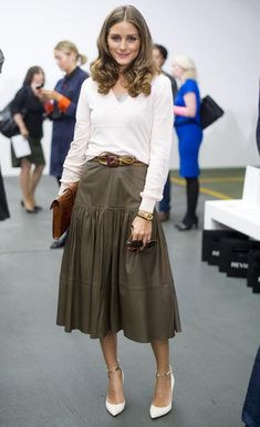 Leather gets the ladylike treatment in an olive green midi skirt as seen on Olivia Palermo on InStyle.