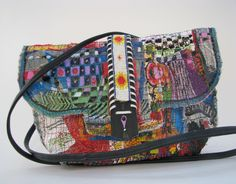 Boho, upcycled bag is made with fused recycled plastic bags, vintage beaded belt, & scrap fabric