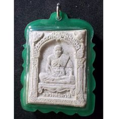 This Amulet is made of Neua Phong (เนื้อผง) with the picture of Luang Pho Kron  (Tok Raja) in front and a Phra Pidta on the back. It was created and consecrated in the year 2548 B.E. in the famous Wat Khao Oor (วัดเขาอ้อ) in Pattalung in order to honor and remember  the famous monk   Luang Pho Kron หลวงพ่อครน (Tok Raja). The Amulet has no temple box but is enclosed in a handmade waterproof plastic case. This Amulet is very good for protection and can besides being worn around the neck also…