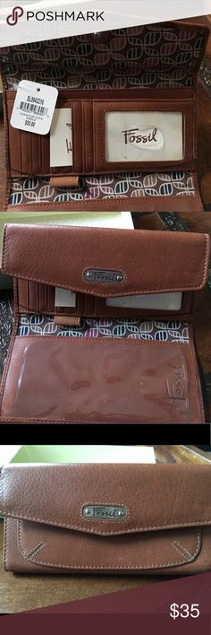 """Fossil """"Olivia"""" wallet/clutch in Saddle NWT (original box included) lovely Fossil wallet/clutch. Deep zippered coin compartment 7.25"""" wide. Checkbook sleeve with plastic divider (for duplicate check writing). 7 card slots and ID window, bills compartment 7.25"""" wide in saddle brown. Fossil Bags Wallets"""